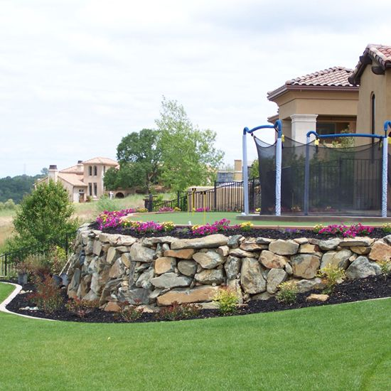 Get river rock landscaping peculiar missouri cjw for Landscaping with rocks and boulders